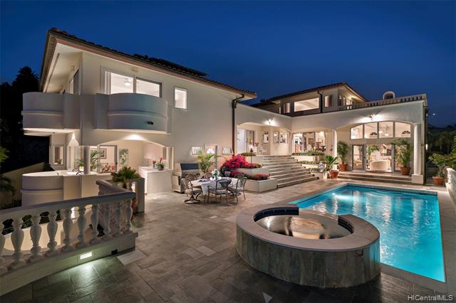 Nestled in gated Hawaii Loa Ridge community, this stately residence commands breathtaking Pacific Ocean, Diamond Head, and dramatic s...