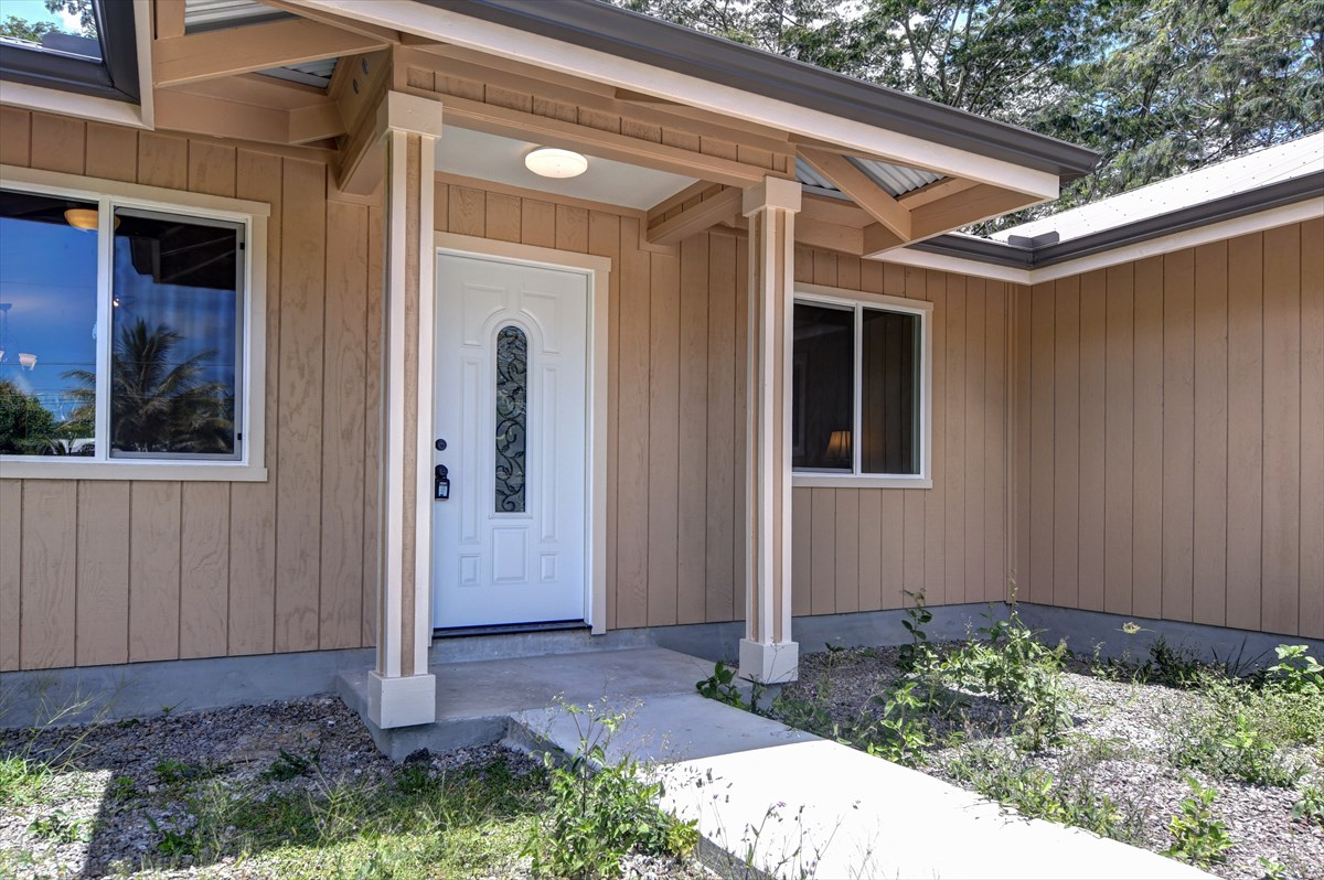 """SELLERS OFFER CREDIT $2,000 TOWARDS BUYER'S CLOSING COST AT CLOSING!!!<br><br>BRAND NEW TASTEFUL SINGLE LEVEL FLOOR PLAN OFFERING 4 BEDROOM 2 BATH, 2,100 SQFT UNDER ROOF POPULAR WAI'OLU MODEL ON 1 ACRE LOT IN HPP. GREAT LOCATION NEAR """"SUN-BELT"""" AREA AND CLOSE TO THE PAHOA AND KEAAU GROWING TOWNS FOR DINNING, SHOPPING, BANKING AND MORE.... ABOUT 8-9 STREETS AWAY FROM THE OCEAN CLIFF AREAS. <br><br>PROPERTY HIGHLIGHTS:<br>*PRIVATE WELL WATER (NO CATCHMENT MAINTENANCE)<br>*SOILD QUARTZ COUNTERTOP<br>*GE STAINLESS STEEL APPLIANCES<br>*SPLIT HOUSE PLAN MAXIMIZES FLOOR SPACE AND INSURES PRIVACY FOR ALL. <br>*SPACIOUS MASTER SUITE WITH WALK IN CLOSET<br>*UPGRADED BATHROOMS <br>*LIFEPROOF VINYL FLOOR AND TILE FLOOR IN THE BATHROOM.<br>*ON DEMAND HOT WATER HEATER.<br>*CONCRETE DRIVEWAY AND WALKWAY"""