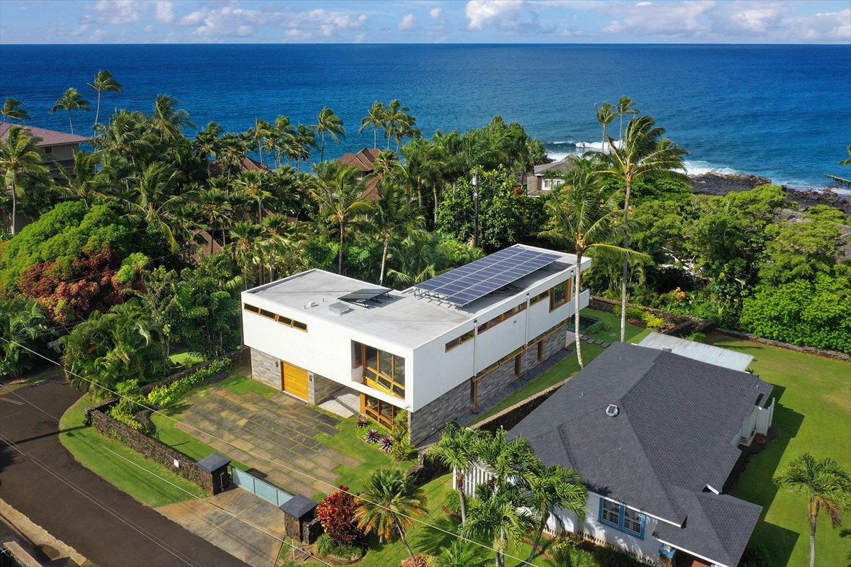 "Modernism: An architectural style that embraces big ideas, beckons strong lines, a seamless flow from indoors to out, an abundance of natural air and light and a strong relationship between the building and its owner. Welcome to Kauai Modern, a 3 bedroom 3.5 bath Mid-Century Modern residence at 2661 Kaheka Road, Poipu Beach, Kauai, Hawaii.<br>Positioned within one of Poipu's most prized and eclectic neighborhoods stands a stunning Michael Piché designed mid-century modern masterpiece. Anchored in the work of the late Vladimir Ossipoff, ""dean of Hawaiian residential architects"" Piché's design is an AIA award winning achievement and an environmental and architectural masterpiece. <br>Utilizing locally sourced materials and craftsmen whenever possible, the Aspen based architect and homeowners implemented a design program that relied upon an abundance of natural materials, glass, warm woods, deep overhangs, strong rooflines, steel framing and a profound relationship to the site and its surroundings. The result unified the flow of indoor-outdoor spaces allowing for the year-round enjoyment of Kauai's idyllic climate. Minimalist interiors feature top of the line appointments with a nod to high island style. A whole home photovoltaic system and solar heating for the pool and spa mirrors the designer's emphasis on long term sustainable living with the carefree sensibilities of living in the islands.<br>From the gated entry to the private backyard pool and spa, this recently constructed 2 story home brings style, form and function to the forefront. Live well here and further enjoy the benefits of a pedestrian lifestyle where the beach, legendary surf spots, dining and shopping are all steps away. <br>Bedrooms: 3 bedrooms <br>Baths: 3 baths + 2 half baths<br>Lot: 10,604 square feet<br>Interior Square Footage: 2617<br>Adjoining Lanai Square Footage: 1244<br>Garage Square Footage: 440 Square feet for 1 Car and equipment rooms<br>Views: Ocean and Mountain View"