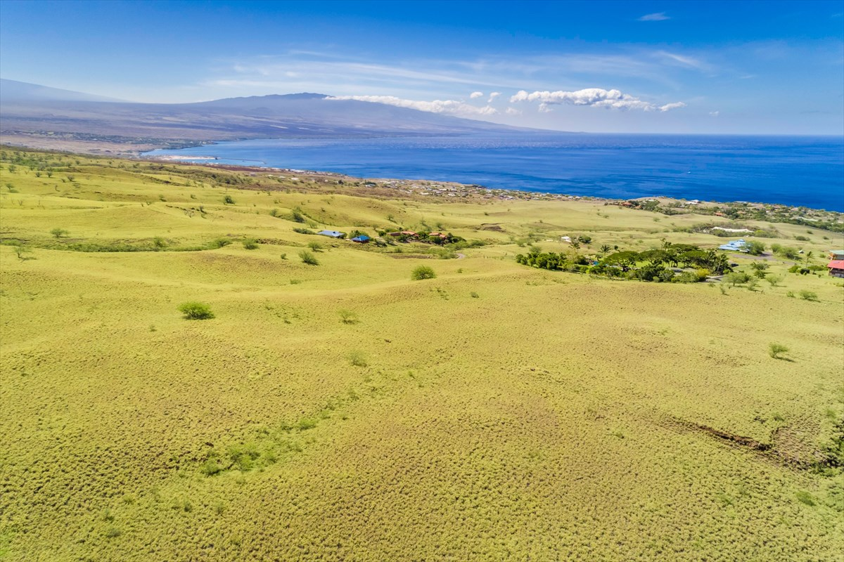 All the tropical visuals of your island vision come to life from the serene seclusion of this elevated, level 13-acres of dreamscape.  Ocean, mountains, sunset, whales swimming along the coast, ships sailing thru the horizon…all here in Kohala Estates.  Best yet…you have relative freedom to create your dream home whether it be an exquisite estate or a family farm…. whatever suits you within the confines of very minimal CC&Rs.  <br><br>The property is located about 4 miles north of Kawaihae Harbor along the sunny Kohala Coast.  Minutes away from the best white sand beaches on the island or the harbor or the resorts and all their fabulous amenities including golf, dining, shopping and fun activities.  Or head north to Hawi to taste the ambiance of old Hawaii. Discover North Kohala's treasures like hidden bays, secret snorkel spots, shoreline fishing, hikes along the coast or thru historic valleys or mountain trails.  All while living in the Sunlight by day, under moonlit star filled skies by night.  Life doesn't get any better, time to start living your dream now!