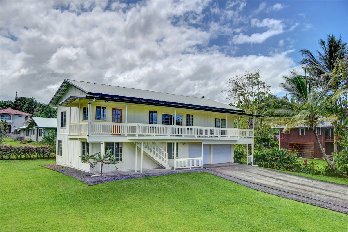 Looking for convenience, comfort and a spacious home close to Hilo?   Then you have arrived!<br><br>This 4 bedroom, 2.75 bath home is located only minutes from downtown Hilo and a quick drive to Honolii surf spot.  The main living area located on the second story has high vaulted ceilings and a large open floor plan.  The living room opens to the breezy covered lanai with lovely expansive views and ocean breezes.  The lanai spans the full length of the house with sliding doors out from both the living room and master bedroom providing a generous additional 722 square feet of living space with ocean view!<br><br>Nice cook's kitchen with lots of cabinets and counters. Kitchen alcove provides room for additional workspace, seating or storage.  On the living room side of the kitchen is a large counter for dining, entertaining or as central desk space.  Open, formal dining space with corner windows and like all the windows in the house have beautiful wood trim accents.  <br><br>Master suite with sliding glass doors to the ocean view lanai and full ensuite bath. Two additional bedrooms upstairs and full second bath. <br><br>Downstairs bonus area has additional bedroom, bath and laundry room.  Fantastic expandable, usable space for your visiting guests or extended family or a generous home office area.<br><br>Grassy lawn with easy maintenance accents and green privacy screen from Kaiwiki Road. <br>  <br>Brand new roof installed in May 2019. New gutters and refurbished fascia and lanai decking. <br><br>Oversize garage for generous car storage or additional space for your workshop or storage.