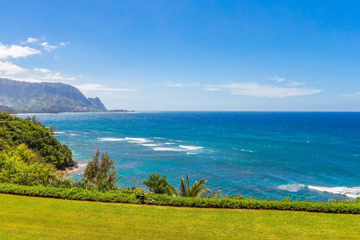 Beautifully renovated ocean bluff condominium with world-famous Bali Hai Sunset view! This 2-story top floor unit at Pali Ke Kua is offered fully furnished as a turn-key vacation rental with future bookings in place. Pali Ke Kua is one of the most desirable condominium projects and vacation destinations in Princeville on the north shore of Kauai. It offers beautifully landscaped grounds and expansive green space in between the buildings. On-site amenities include an inviting swimming pool and hot tub, a private, paved path down to a sandy beach cove, and a popular restaurant, Hideaways Pizza Pub. Great whale watching from the ocean bluff in the winter season and best location to watch sunsets on the north shore all year long! The Princeville Resort Hotel is within a short walking distance down the road overlooking Hanalei Bay. The Makai Golf and Tennis Club Facilities and Princeville Shopping Center are a short drive up the road. This beautiful ocean bluff unit at Pali Ke Kua is a must see!