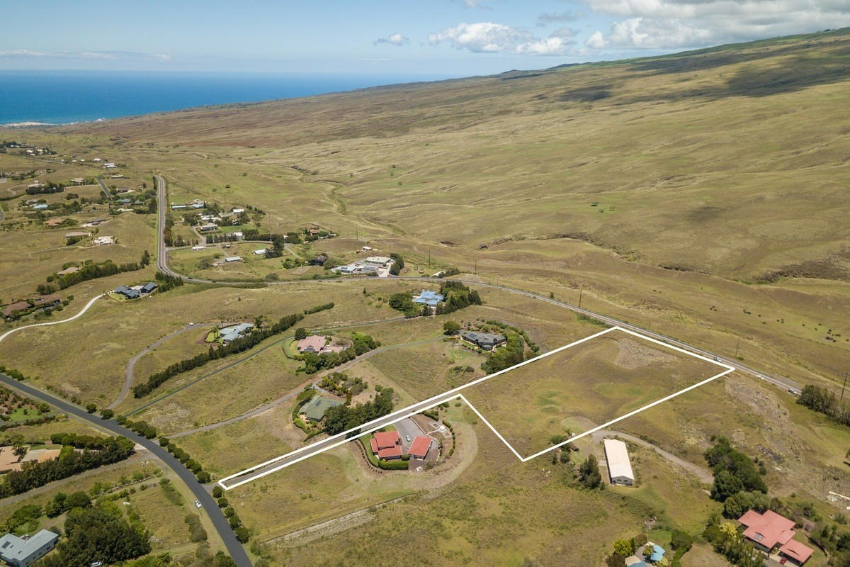 Anekona Estates is a highly sought-after neighborhood on the dry side of Waimea.  This 3+ acre flag lot has two flat / buildable areas and already has fencing along Kawaihae Road, and both sides of the lot.  If your idea for your dream home includes some ocean view, then you might consider the upper portion of this lot to build.  There is a gentle slope to the land and a lower flat / buildable area too. Either house site would allow for awesome mountain views.  The driveway is part of this sale and the lower neighbor has a recorded easement for the driveway to this point where the paving ends.  Utilities have been pulled in along the driveway underground to protect the surrounding views.  This is a great opportunity to build in one the best neighborhoods on the island!