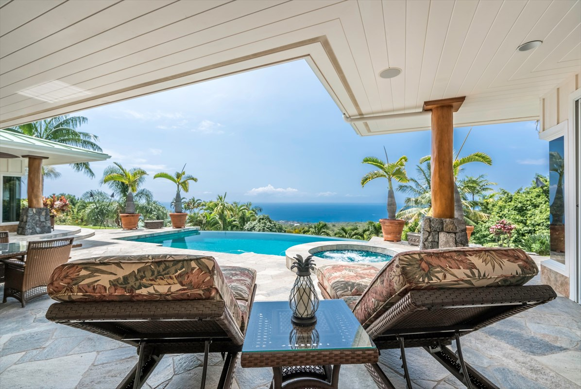Elegant leisure permeates this Kailua-Kona Estate at a cool elevation overlooking the Kona coast. Hypnotic views lure you into a tropical trance where all you want to do is lounge in the shady lanai along the refreshing pool.  Step back inside Fleetwood pocket doors to travertine floors that cool your feet through the lofty light and airy great room to a kitchen that chefs dream of.  Family and friends join your culinary adventures in seats along the island topped by rainforest granite.  Everyone loves the conveniently located intra-island wine chiller. Lots of ingredients can fill the generous pantry and Jenn Aire fridge. Glass etched by a local artist fronts some of the high-quality cabinetry. Adjoining dining room includes awesome views. An outdoor kitchen lies just outside next to the lanai dining area. <br><br>Koa built-ins accent the great room that separates the Junior Suite from the Master Suite.  The junior suite bath highlights rainforest granite.  The extravagant master bath has  a jetted tub, curbless walk in shower, dressing table, bidet. Includes a pair of walk-in closets.  The office and laundry room sit between the master suite and the garage. <br><br>Above the garage is the 2-bedroom, 1 bath Ohana with kitchenette and private deck with ocean view beyond the garden views.  Truly tropical landscape filled with bright flowers and colorful exotics surround the home. The garage is extra large with space for 3-cars. The attached boat shed/carport gives you more room for all your toys. Private driveway softly lit by solar lights is artistically gated within the gates of Mahi Iu Lani, a neighborhood that consists of only 6-properties.<br><br>Property is easy to show to qualified buyers.