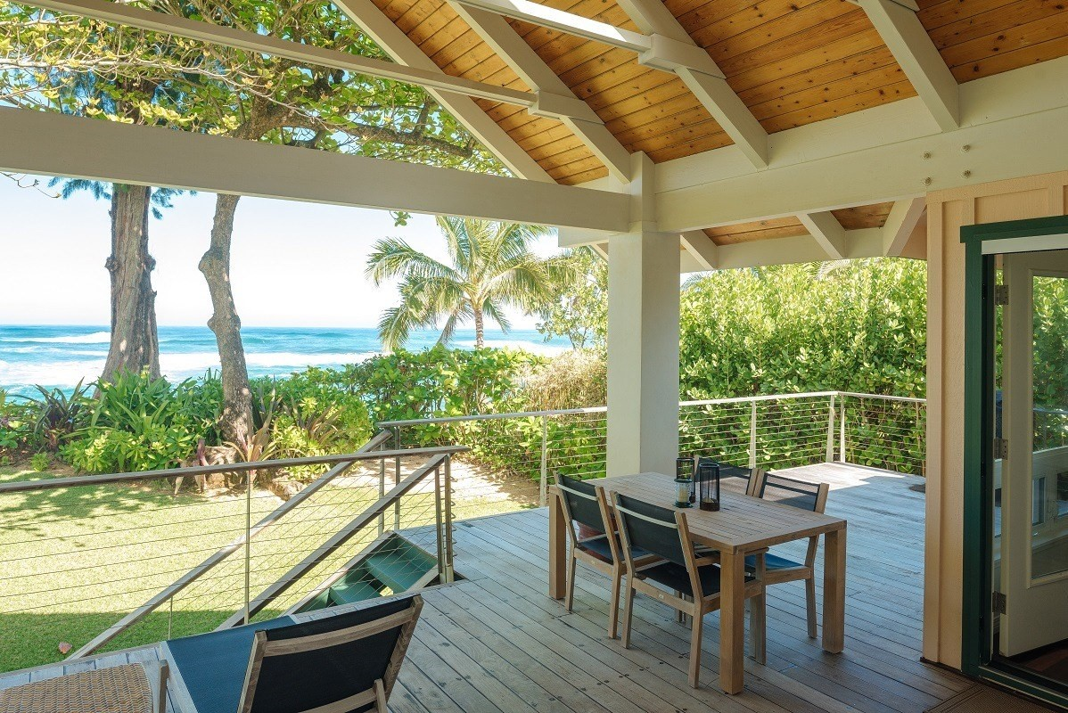 Dreamy location for this great Kauai north shore beach house.  Off a quiet road this house and in front of an idealic quiet stretch of sandy beach out of the wind.  The Naue Cove offers swimming and advanced water-sport like surfing, kite-surfing, windsurfing and more.  This home has both a non-conforming Transient Vacation Rental Use Permit (vacation rental license) and the property has guest house rights.  This dreamy home has an open, light, and modern floor plan, large lanai, and views from every window!