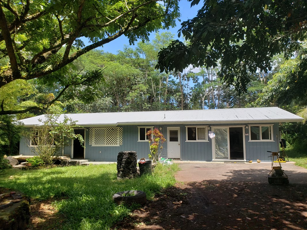 This a 3 bedroom, 2 bathroom home located in beautiful Hawaiian Paradise Park between Kaloli and Paradise.  It is located on a paved road on the makai side of the road.  Home has had new gates installed and has a circular driveway for ease of entry and exit.  Home needs some TLC but is has great bones and just needs someone to bring it back to its former glory.