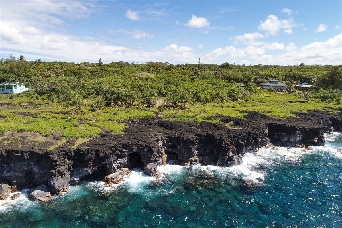 $52,000 price drop!  Grab it now.  Seller motivated to move this gorgeous oceanfront lot.<br><br>Looking for the Hawaii of yesteryear?  It still exists here on the eastern shoreline of the Big Island of Hawaii. Waa Waa is a smaller Big Island subdivision, the eastern edge of which runs all along the shoreline.  Beauty abounds in every direction you look with native trees, stunning sunrises, ocean horizon, and majestic clouds. Running along the ocean edge of this property and the entire subdivision, is a narrow strip of land that is owned by the homeowner's association granting access to walk, fish, or enjoy watching the waves as they break against the lava rock wall.  Sea turtles abound in this area and are often seen feeding along the ocean edge. <br><br>Government Beach Road, which is the entry into Waa Waa and running parallel to the ocean, is paved. Access onto this 1.45 acre property is directly off pavement, so no dirt roads to travel home.  <br><br>With almost an acre and a half, you can enjoy privacy along with unobstructed ocean views.  The weather in this area is great, referred to as the banana belt, with lots of sunny days but also ample rain for your water supply via your catchment system.  <br><br>The current owner has not done any development on this property since purchasing so it is a blank slate for your creative inspiration. Lovely homes are on this stretch of ocean front lots adding to the property value of the immediate area.  <br><br>Don't miss this opportunity as this lot has not been on the market in 21 years!