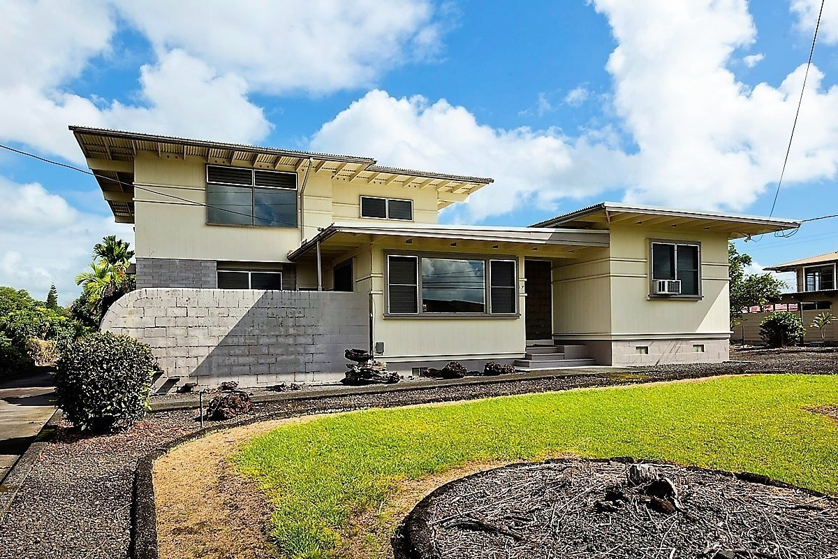 In the Heart of Hilo sits this unique 3 bedroom, 2 bath home. Once you walk in through the double doors into the living area sits an inside BBQ area, the grill was built for the use of an inside a BBQ with a hood vent and concrete bar. Right out the living room windows is where there is a Koa pond, waiting for you to fill back up and use. The kitchen with a lot of storage opens up to the living area and dining room, right down the stairs off the kitchen is the basement with the laundry area. With an inclosed Basement is a great use of space for anything you desire. The 2 bedrooms and guest bath sit on the first floor of the home with original hardwood floors. On the second floor is a Master Suite, with living area, walk-in closet and master bath. <br><br>The home has a bomb shelter with electricity and water, the bomb shelter can be used for storage. On the top of the bomb shelter would be a great place for a Hot Tub or outside BBQ area. In the covered 2 car carport has a workshop area <br><br>With just minutes to Hilo town, restaurants, stores, entertainment, UH Hilo, Hilo Community College is the great location.<br><br>This is a home that you have to see to appreciate all the uniqueness.<br><br>Invest in yourself, and Call Hawaii home.