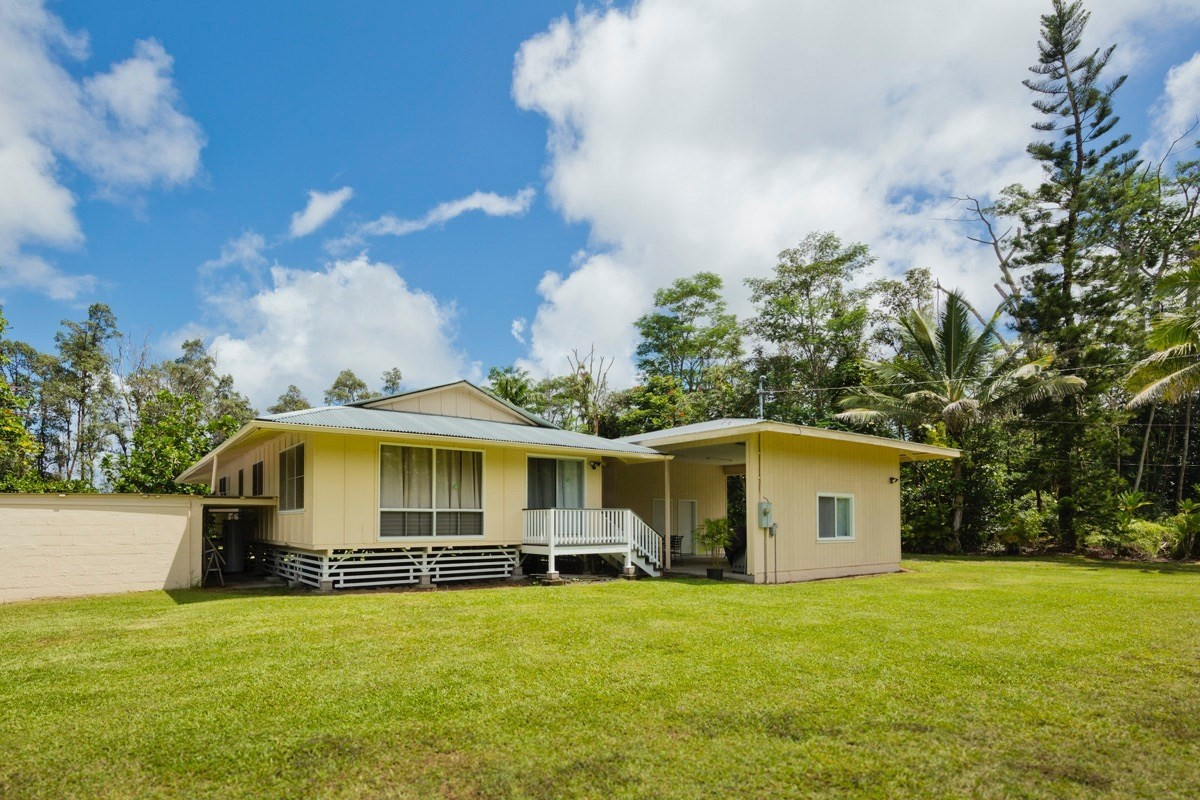 This Kama'aina style home is ready for its new owners to make memories. <br><br>Located near the top of the subdivision on paved road, this home is located only minutes from the highway. Charming features include ceiling to floor windows in the living room. Cozy front porch located off the of the dinning area. Indoor laundry for your convenience. This home comes with 2 carports. Main carport has a bathroom with shower.  There is a separate (unpermitted) 28x18 carport in the back of the home than has many possibilities. Among the landscaping you will find mature fruit trees such as lychee, ulu and banana, with plenty of yard space for the keiki to play.<br><br>Offered at this affordable price it won't last long. Take a look at it today!