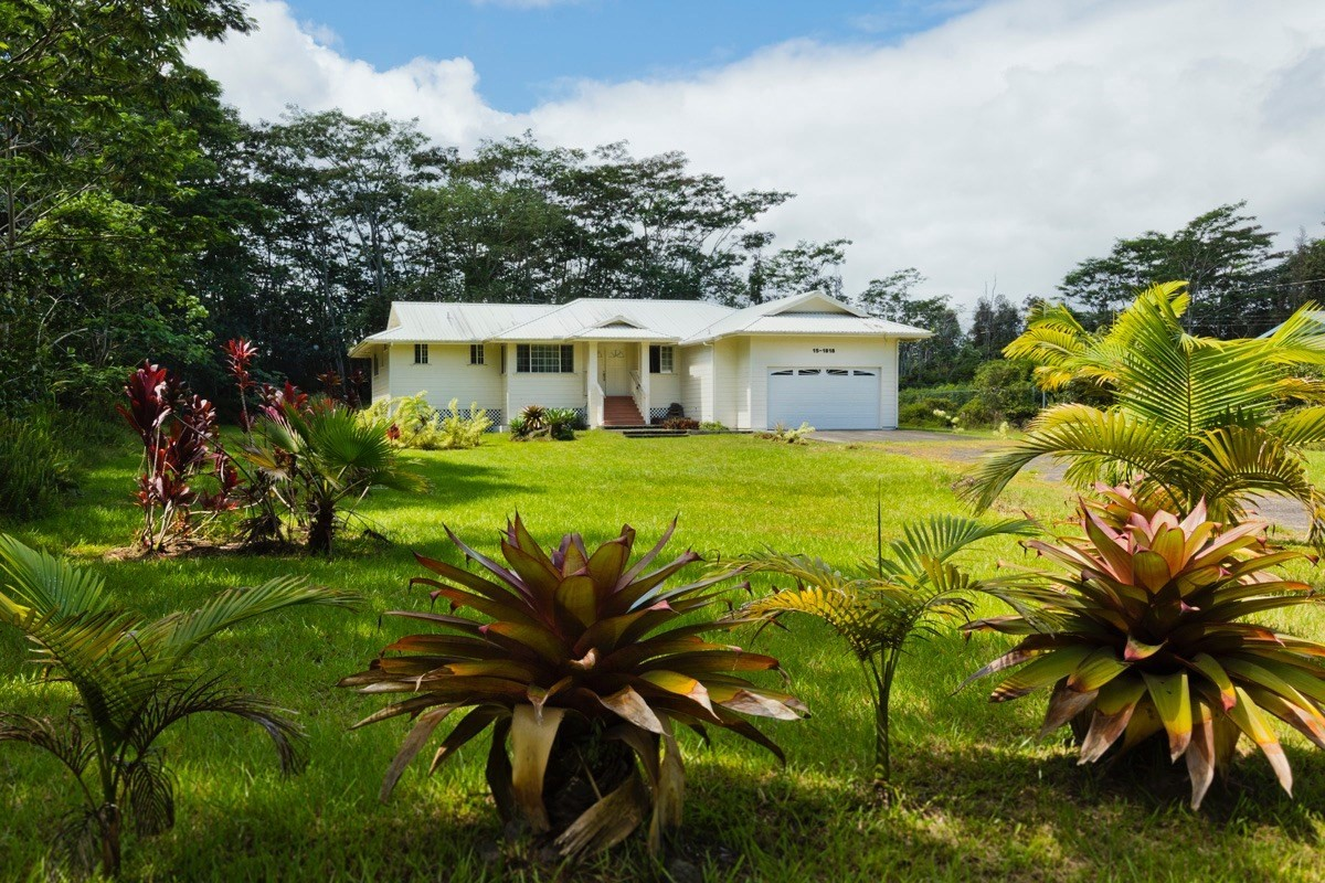 "Post and Pier floor plan in Hawaiian Paradise Park on 17th Avenue with 1 acre of land that has an open mowed lawn. 4 bedroom, 2 bath home, with over sized garage.<br><br>The home offers recessed lighting in the kitchen & living room, includes a built-in recessed display area, master bedroom has a walk-in closet and master bathroom includes an over sized jetted tub.<br><br>Split floor plan, master bedroom located on one side of the house and 3 bedroom and bath on the other side of house. Property to be sold in ""AS IS Condition"". SALE INCLUDES: Abandoned mini-school bus located on the back right area of the lot. Buyer or Buyer agents must investigate towing removal options during J-1 property inspection time frame. <br><br>For HPP fees and road maintenance information, please check https://www.hppoa.net/, call: 808-966-4500, or email: info@hppoa.net"