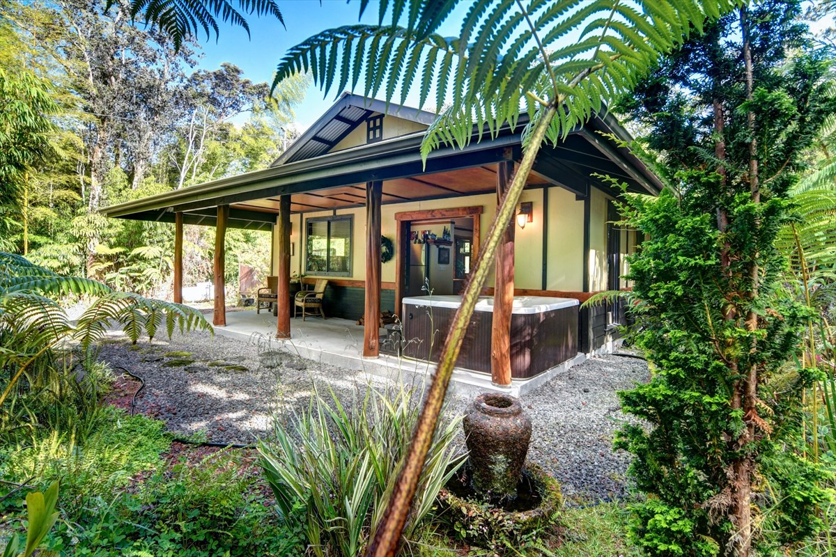One of three Volcano vacation rental cottages.   Only minutes away from Hawaii Volcano National Park, the #2 tourist attraction in the state of Hawaii. Seller prefers selling together, MLS #632995, #632986 and #632991. <br>Well established and efficient.  Occupancy up to 90%.  All three cottages are fully permitted as short term vacation rentals under Bill 108.  Easy clean up, less maintenance, less wear and tear. Great for honeymooners, anniversaries or re-kindling. <br>This one of a kind studio cottage is nestled in a half acre of rainforest, alive with singing native birds.  The house is located a short drive to Volcano National Park and to the charming Volcano Village, the small commercial hub for the surrounding community.   Titled the Tsugi Teahouse, the interior is trimmed with Tsugi pine. The beautiful Tsugi Pine tree was brought to Hawaii by Japanese immigrants in an earlier era and the use of it in the cottage reflects the history of the surrounding community.  The wood adds a natural organic charm to the house.  Japanese styling and effects, such as the sliding shoji screen doors in both the entryway and the bathroom, give this cottage a romantic atmosphere that's a perfect blend of contemporary and traditional Japanese style.   Designed with relaxation, romance and luxury in mind, it comes complete with a hot tub, king bed, and comfy furniture to snuggle in while watching a toasty fire on a cool winter morning. A small but modern kitchen with full size appliances adds to your dining in experience. If you are in the mood just to stay in and be your own chef. Granite counters, stainless steel appliances and fully equipped with cookware and dining ware. Over the bed is a dramatic round window, flanked by shoji screen privacy shutters. A contemporary slate tiled accent wall is a nice accent.  Vaulted ceiling above and beautifully crafted sealed concrete floor below.<br>Come enjoy the Tsugi Teahouse!