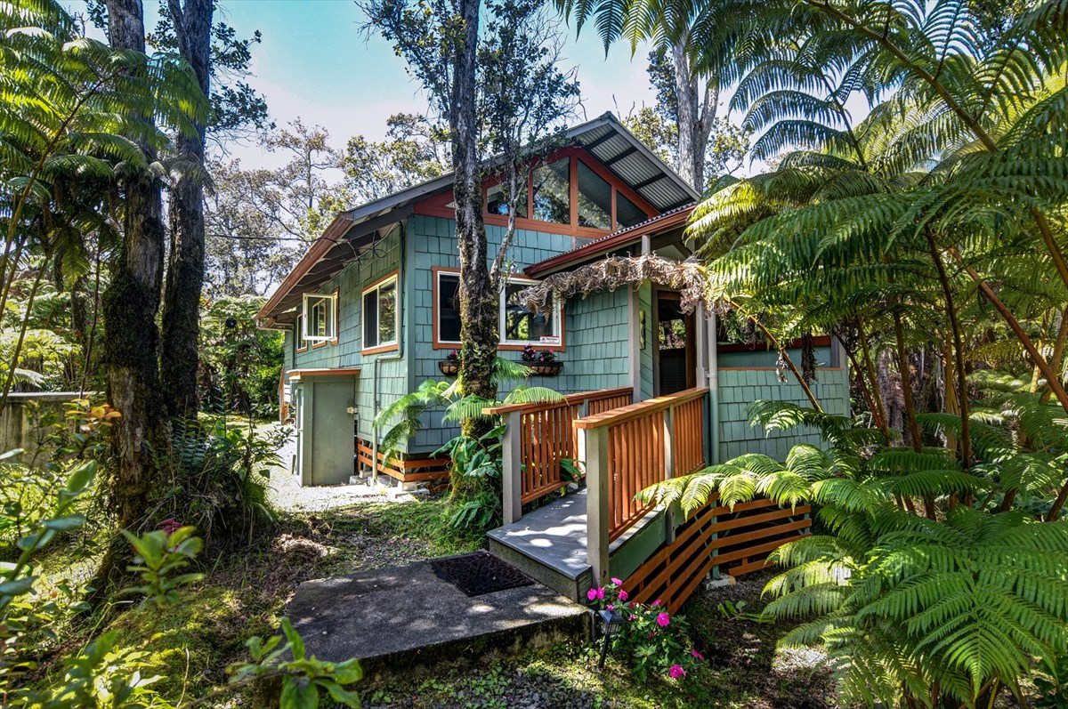 One of three Volcano vacation rental cottages.   Only minutes away from Hawaii Volcano National Park, the #2 tourist attraction in the state of Hawaii. Seller prefers selling together as a package -  MLS #632995, #632986 and #632991. <br>Well established and efficient.  Occupancy up to 90%.  All cottages are fully permitted as short term vacation rentals under Bill 108!<br>Easy clean up, less maintenance, less wear and tear.  Great for honeymooners, anniversaries or re-kindling. Fabulous second home retreat. <br> <br>This magical cottage brings to life to your dream of living in the cool forest of the Big Island's upcountry.  The woodsman's craft is highlighted here in the all wood construction combining Fir and cedar.  Treasured materials include repurposed wood from a circa 1900 Kona Coffee Mill worked into interior walls and flooring.  Cedar shingles on exterior walls add charm and insulation. Start vacation renting your Volcano cottage immediately!  Sold Turn Key. <br> <br>The current owner brought the property up to current standards to comply with not only the  current building code but also with a contemporary aesthetic.  Shiny new stainless appliances and sleek cement countertops sparkle in the kitchen.  The all wood cabinets throughout are highlighted by a solid granite counter in the totally remodeled bathroom.  All new light and plumbing fixtures.  New Life proof flooring is durable and easy to maintain. Stacked Travertine wall surrounds the electric fireplace (another easy maintenance feature) and TV.  Add to this the new roof, the freshly painted interior and exterior including the front and rear porches and you have your virtually new home sweet home.<br><br>The concrete water tank is another plus.  Telephone, electricity and Wi-Fi service. Gated entry. The location in Hawaii Orchid Isle Estates is very desirable given that all lots within are three acres, each arranged in a perfect square.<br><br>Come enjoy the Tsuji Pinehouse!