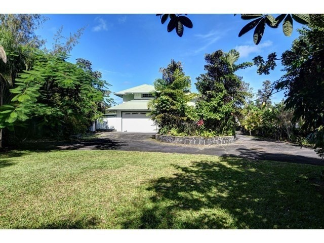This beautiful home is located just minutes from the Ocean in Hawaiian Paradis Park.  Home has rock walls all the way around and is on well water.  This lovely home has 4 bedrooms and 2.5 bathrooms. It also has two large lanais running the length of the home, great for entertaining or just relaxing and enjoying the tropical sea breezes.<br><br>This large 2,128 sqft home has a fantastic open layout. The large Living room has a vaulted open beam ceiling, beautiful wood flooring. The kitchen is well laid out and an area you will love to cook in.  Upstairs features 4 bedrooms and 2 bathrooms, perfect for the family.  <br><br>The yard is well groomed and has lots of parking.  Short walk to the ocean. Home has a large garage and a large bonus storage area (unpermitted) on side of the home.  <br><br>This property has it all, this is a must-see and it is priced to sell!!