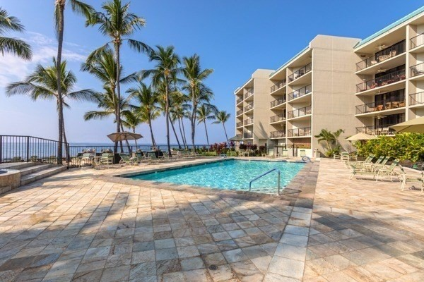 Updated unit in desirable Kona By The Sea condominiums. KBS is the premier Ocean Front destination located on Historic Alii Dr. Solid concrete construction, elevators, covered parking, central AC, Heated ocean front pool and hot tub, private sandy beach and BBQ's, lush tropical landscaping, pet friendly complex, no smoking complex.<br><br>KBS 1 bedroom units are some of the largest offered on the Big Island of Hawaii, 919 Square feet, 2 Full bathrooms, spacious covered lanais, and ocean views. Clean and comfortable inside and out. KBS offers excellent on site management that is attentive to every detail. This is an ideal place to call your Hawaii home.<br><br>Short term rental less than 30 days must be managed by Aqua/Aston.