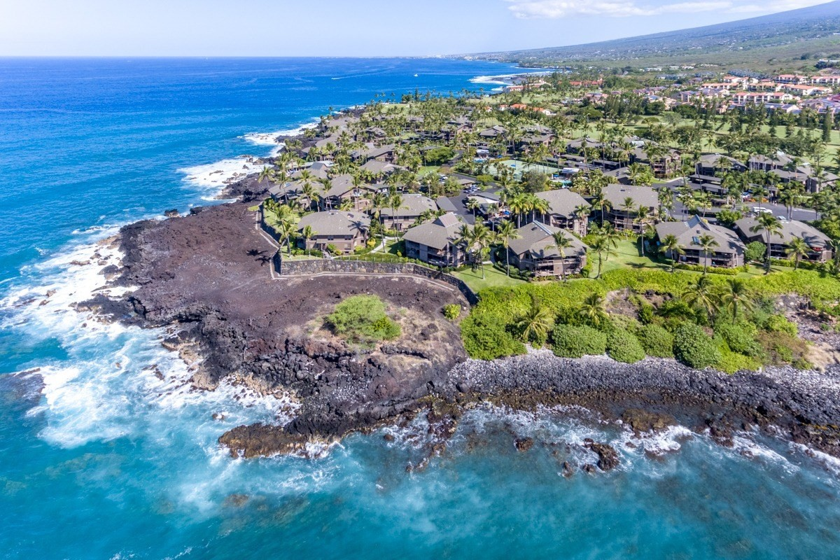 LOCATION LOCATION LOCATION!!! This luxury vacation condo is located in the prestigious Kanaloa at Kona, a gated resort community, just 10 minutes south of Kailua Kona in Keauhou. In this secluded location, you will awaken to the songs of tropical birds, restful sounds of the ocean, and be mesmerized by the spectacular ocean view from your private lanai. The Condos on He'eia Bay are the most desirable in Kanaloa and don't come on the market very often. This extraordinary rare condo has it all with the best location and view! Enjoy watching the outriggers come and go from Keauhou bay and the surfers in He'eia Bay as the winter swell rolls in. Also at night, you can see the manta ray dive boats anchor in front of the Sheraton. This location also<br><br>Incredible Features:<br>- Vacation Rentable<br>- Vaulted ceilings and skylights allow for natural light and ambient space.<br>- Newer appliances installed in 2016<br>- Beautiful kitchen with stunning granite counters. Large enough to accommodate multiple cooks and is equipped to please even the most discerning chef.<br>- Full-sized washer and dryer will make laundry a breeze.<br>- In the master suite, you will find a luxurious king-size bed with high-quality linens, smart TV, walk-in closet and an en suite office. The stunning master bath boasts a large walk-in shower, granite double sink vanity, dressing area, and a private water closet.<br>- The second bedroom is very spacious and has a large walk-in closet.<br>- The guest bath has a custom tiled shower and double sink vanity with beautiful granite.<br>-Central AC throughout the condo makes you feel comfortable when stepping into the condo<br>-The loft room has been increased in size with plumbing in place if the next owner chooses to add a bathroom.<br><br>Amenities of Kanaloa include: 3 separate pool areas, each with hot tub, bathroom facilities, BBQ's, 2 tennis courts, family area, and a concierge desk which will help you and your guests
