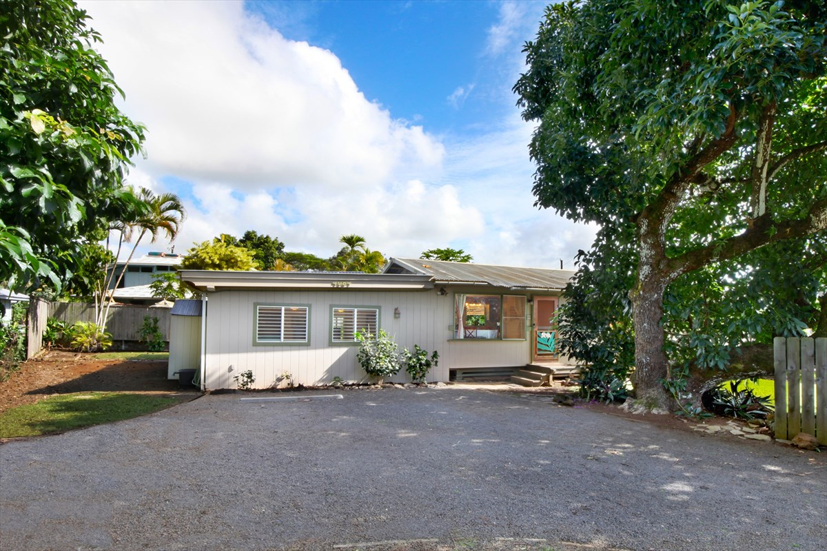 """Looking for a Kauai cottage on the beautiful south shore of Kauai? Look no further than this crisp and clean home in lush Omao with a host of upgrades. <br>This new listing is one of the least expensive homes available on the entire south shore of Kauai and the closest to Poipu Beach. The grounds are mature and include what many deem as the """"best avocado tree on the south side"""" with its fruit sold at local shops such as Living Foods and the Koloa Fish Market. A private backyard is ideal for gatherings and barbeques.<br>Inside, the home lives spaciously with a 2 level great room featuring a deluxe kitchen and oversized island – perfect for parties and a bite at the bar.  Bedrooms are quaint, present with clean lines and all bathrooms are newly upgraded.<br>Features and benefits of this listing include:<br>•    New bamboo flooring through kitchen and bedrooms<br>•    New wall to wall carpet in the living area<br>•    Newly upgraded bathrooms<br>•    Marble kitchen island and marble + maple kitchen countertops<br>•    Subway tile backsplash in kitchen<br>•    New stainless Refrigerator<br>•    Freshly painted interiors<br>•    Photovoltaic and Tesla power wall<br>•    New lighting fixtures<br><br>The 3 bedrooms 2 bath home is on a sleepy side street just off of Omao Road placing you within a 5-minute drive of Old Koloa Town. A few minutes beyond is Poipu Beach and its array of activities. The airport, hospital, and Lihue are within a 20-30 minute drive. <br><br>THIS LISTING WILL NOT LAST LONG!"""