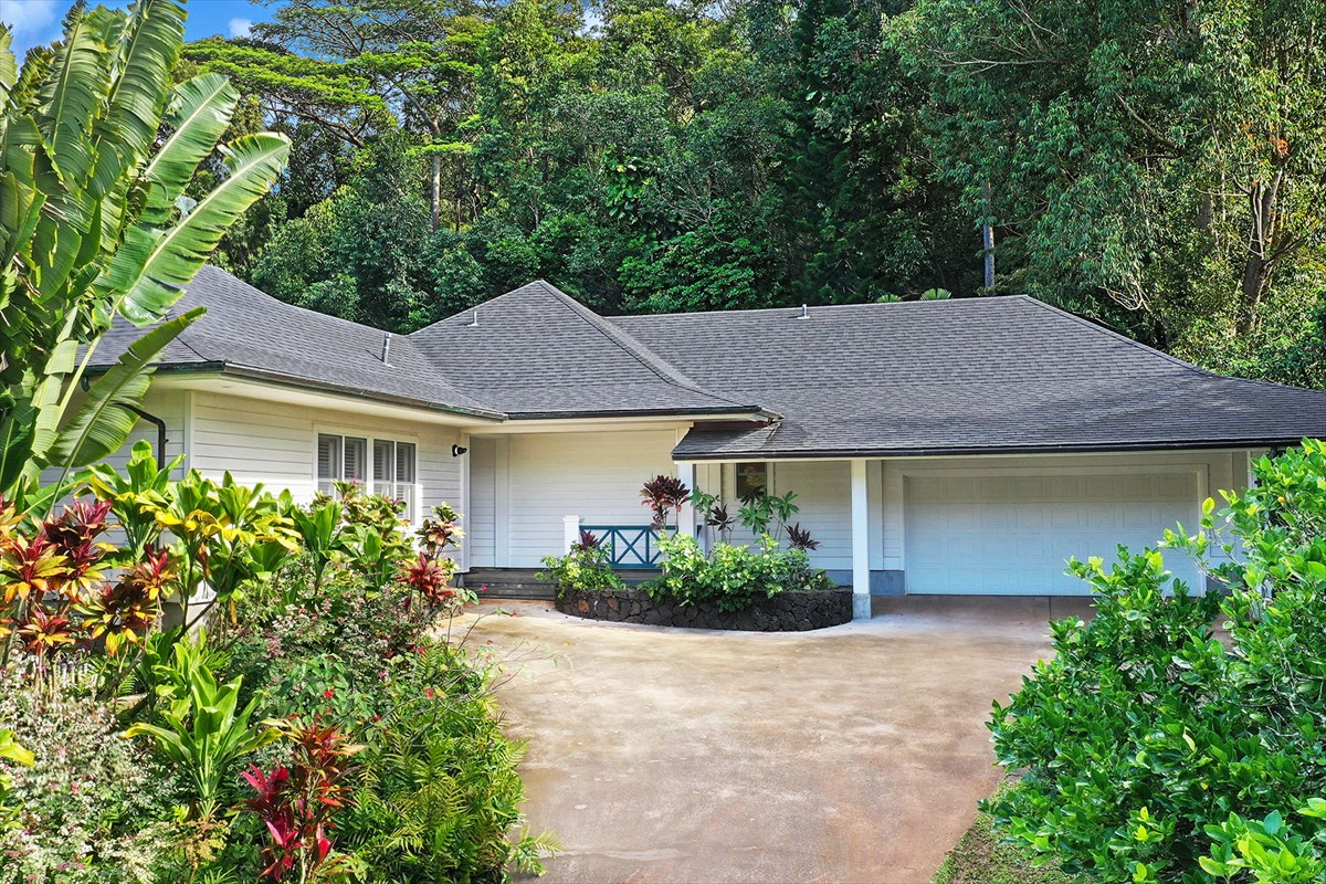 This property brings VALUE. $1,595,000 for an incredible home with 4 bedrooms + pool on 1.80 acres.<br><br>On Kauai's south shore stands this single level and private plantation-style estate. Complete with a stunning Hawaiian roofline, this home's inviting exterior is emblematic of Kauai's architecture.  Set within cool Lawai Valley, yet moments away from the sand at Salt Pond and Poipu Beach, this 4 bedrooms 5.5 bath home with pool and 2 car attached garage is a delight to any who want extra room in an ideal location.<br><br>Enter through the foyer and find a great room featuring high ceilings, wood floors, a fireplace, and built-ins. The kitchen is fully equipped and boasts extensive storage, a walk-in pantry, granite counters, and an eating bar. <br><br>Large windows and doors bring the beauty of the setting inside and invite to the pool lanai. Fruit trees, tropical flora, and fauna surround and provide shade where desired within the large grassy areas. A party here is a snap with the combination of the great room, adjacent sunroom and pool lanai which all lend ample space to accommodate any need. <br>Bedroom suites include en-suite baths (master bath includes 2 baths), privacy and a focus on the garden environment beyond.  Each bedroom is airy and light-filled with three rooms opening to the sun-room and/or pool. <br><br>Feature List Includes:<br>Interior Area: Approximately 3,490 square feet <br>Bedrooms/Baths: 4 bedrooms and 5.5 baths<br>Land Area: 1.80 acres <br>Pool and Spa: In-ground<br>Landscaping: Tropical with specimen trees<br>View: Garden, valley, and mountain <br>Rental Status: Not zoned for vacation rental. A perfect family home/retreat
