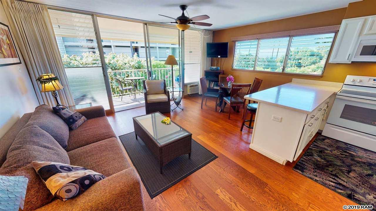 Spectacular top floor, ocean-view end unit at Kihei Kai Nani, one of south Maui's most desirable vacation spots. This 1br/1ba penthouse was remodeled in 2017, with wood floors, new cabinets, Silestone countertops, and new appliances. The bathroom was updated in 2014 with a full walk-in tiled shower. Being an end unit, it has an extra set of windows along the west side for added light and to enjoy the ocean breeze. And, on those days when you need to cool off, there is air conditioning in both living area and bedroom.   Property is being sold fully furnished so just bring your suitcase and enjoy your vacation.   Located directly across the road from Kamaole II beach, you'll have your toes in the sand within minutes. Proximity to South Maui's finest shopping, restaurants and beaches make this one of Kihei's favorite locations.   The property is heavily booked through February 2020 and buyers must honor futures bookings. Do not miss this one as it will not last long. Call your favorite REALTOR to schedule a private showing today.