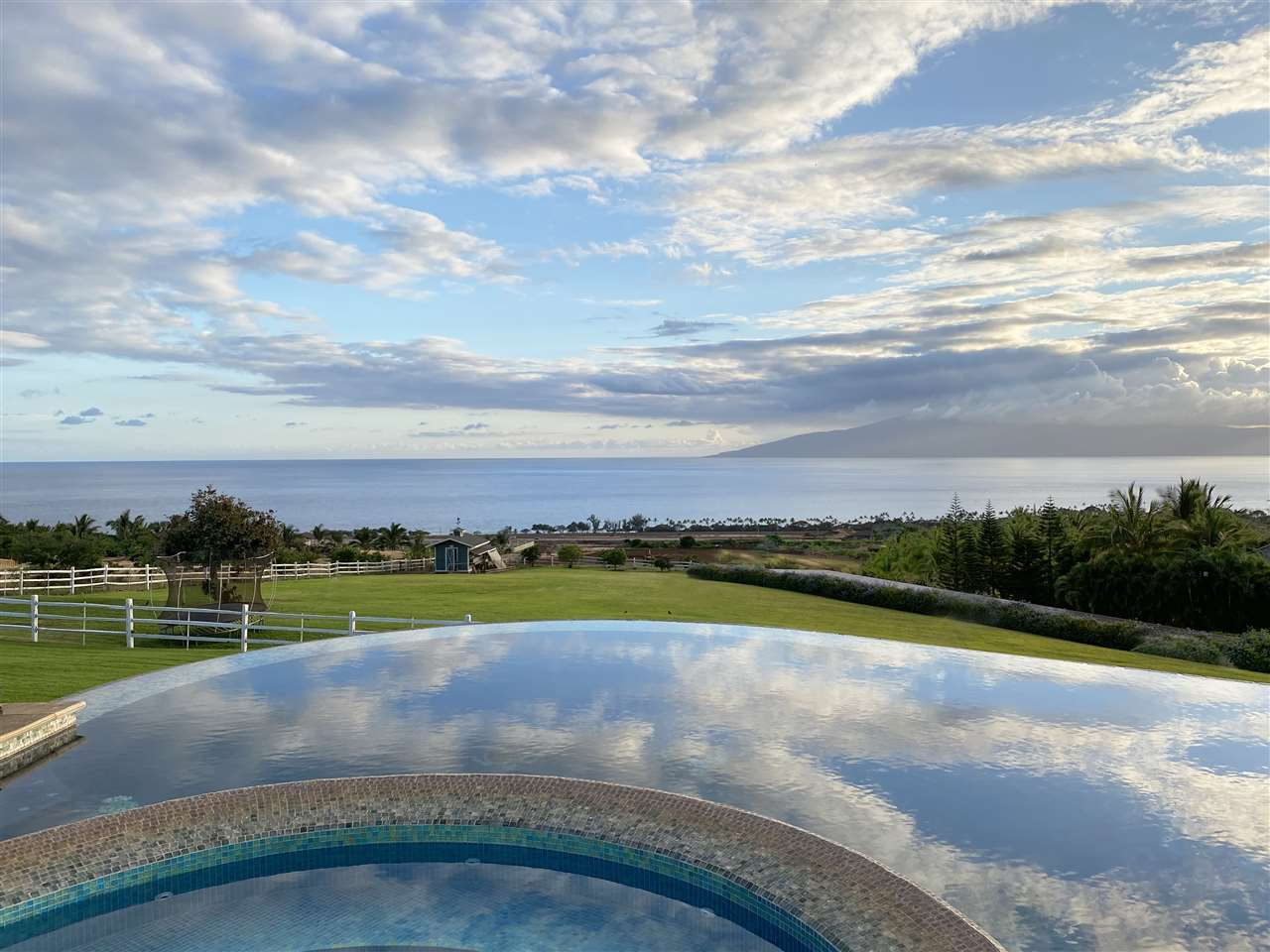 Island dreams? Make them come true! Live, work and play in this gorgeous estate on Maui! Gracing the slopes of the West Maui Mountain...